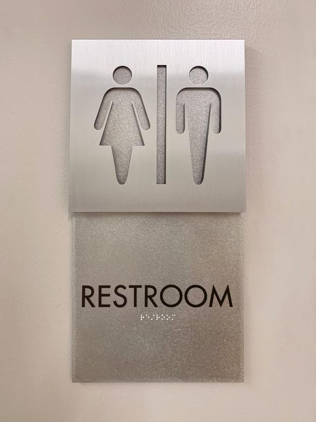 Indeed Tower - Interior Restroom Plaque