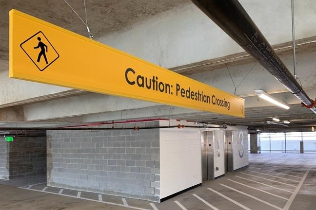 Crown Castle Headquarters - Garage Overhead Banner Caution